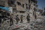 Опубликовано видео из сданного российским военным анклава боевиков на юге Сирии