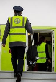 Из-за грозившей  взрывным устройством на борту самолета женщины началась проверка всех авиапассажиров