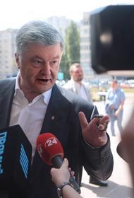 Порошенко вернулся на Украину  после обвинений в побеге