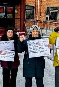 Штраф за пикет  получила жительница Усть-Илимска. Удивительно, но акция была организована в поддержку Путина