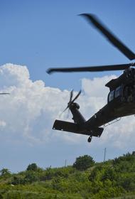 РИА Новости: появились кадры с «подвешенным» к вертолету талибов человеком