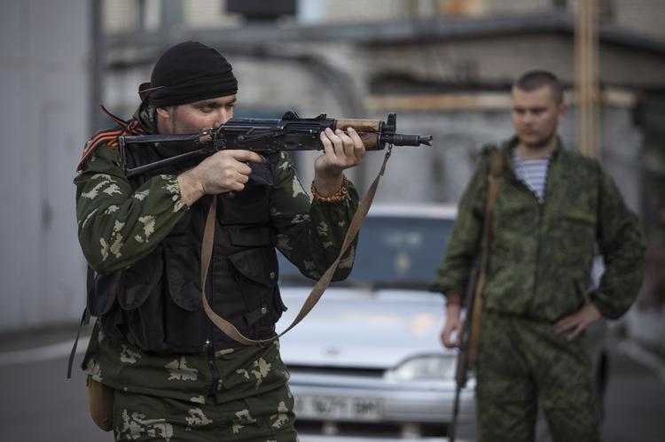 Видео пулеметной атаки ополченцев Донбасса по позициям ВСУ показали в интернете
