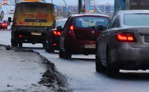 Московских водителей предупреждают о гололедице и сильном ветре