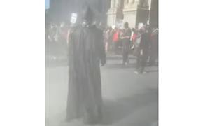 На массовых митингах в США появился Бэтмен